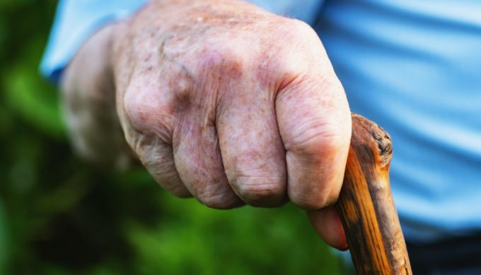 hands-of-an-old-man-holding-a-cane_t20_jo71vd