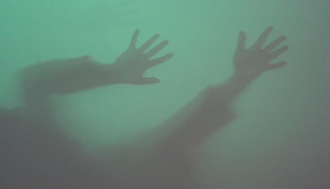 silhouette-of-hands-on-the-wall-ghost-shadows-wall-background-strange-shadows-and-light-green-color_t20_kLJr7X